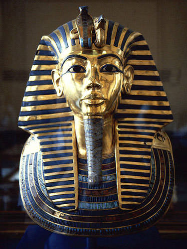 Golden funeral mask of king Tutankhamen inlaid with lapis lazuli and turquoise