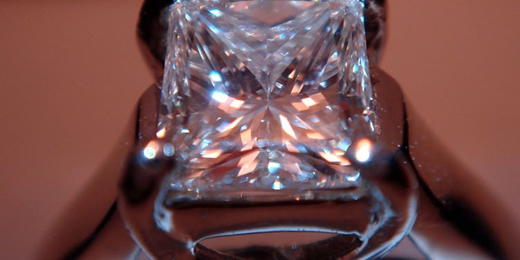 Diamond ring close-up - the risks of re-polishing diamonds