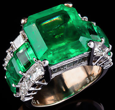 Emerald ring with diamond sidestones.
