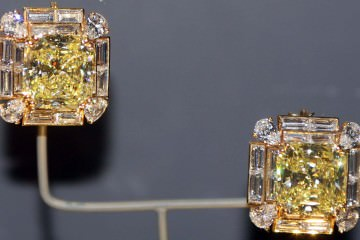 Each of the Hooker earrings feature a 25.3 carat fancy yellow diamond