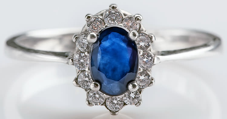 Blue sapphire engagement ring with halo in white gold