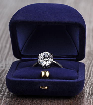 Diamond engagement ring in blue gift box
