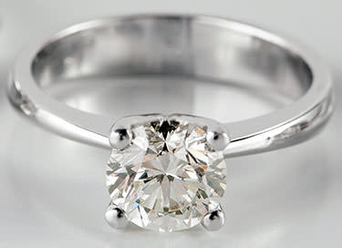 Solitaire diamond engagement ring four prongs
