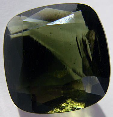 A moldavite gemstone (cushion cut)