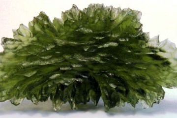 A museum grade moldavite (tektite) specimen - also known as 'flower burst moldavite'
