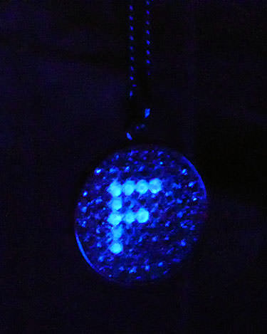 Fluorescent diamond necklace under UV light
