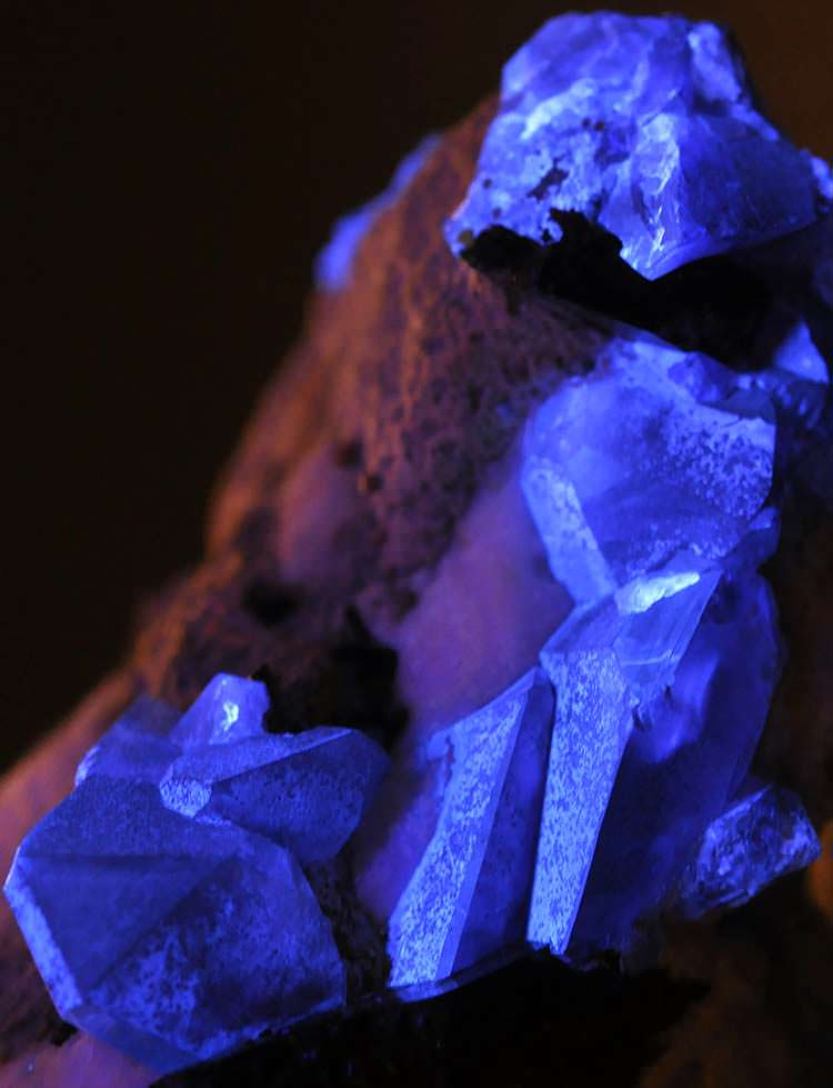 Benitoite crystals under UV light (Benitoite is fluorescent)