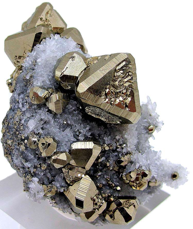 Pyrite crystals on a pyrite matrix covered with small quartz crystals