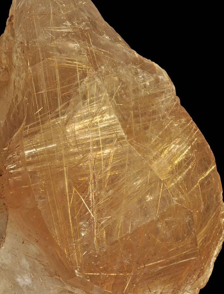 Rutile crystals inside a citrine crystal