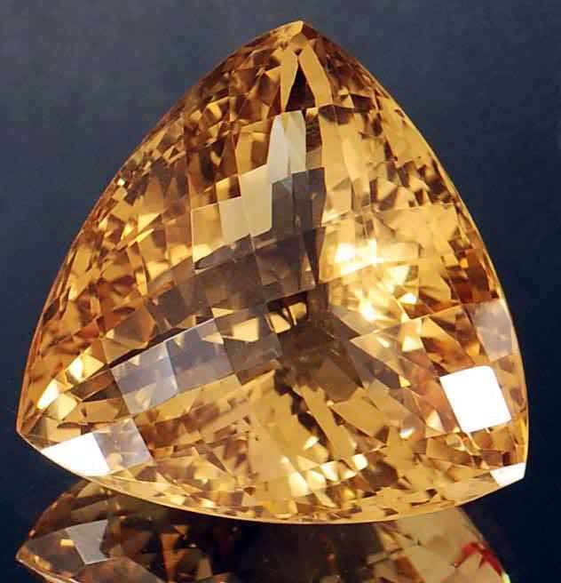 Trillion cut yellow-orange citrine gemstone