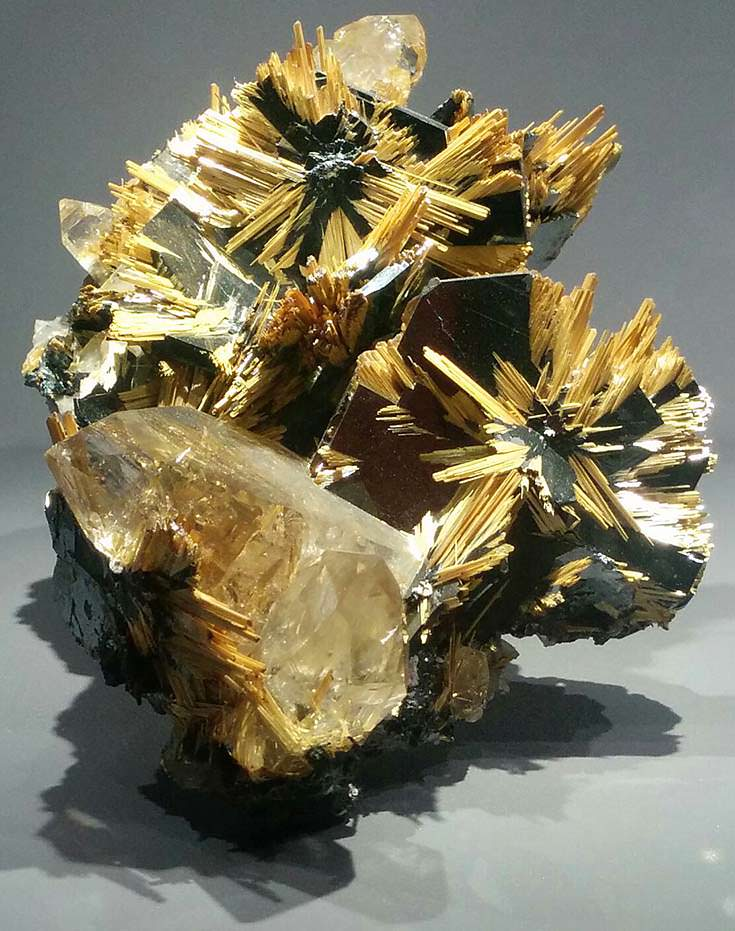 Rutile (yellow) on hematite from Brazil