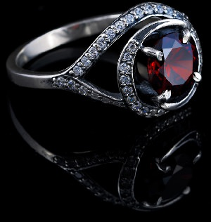 Silver ring with precious red gemstone