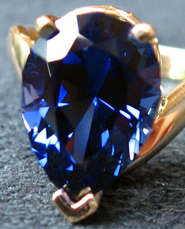 Pear cut blue sapphire ring - what color is sapphire?