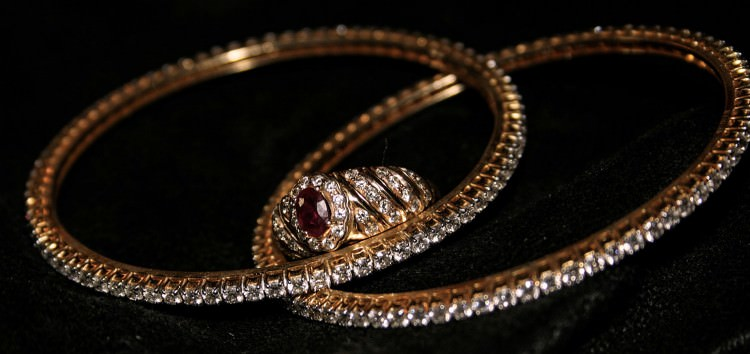 Diamond bangles with diamond and ruby ring - when to hire a professional jewelry cleaner