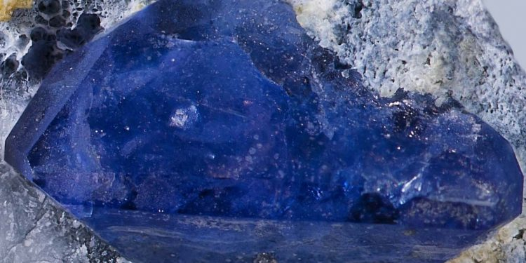 Blue benitoite crystal on matrix from the USA